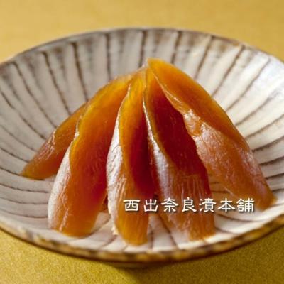 守口大根(もりぐち)奈良漬 紙包  -  歯切れがよい愛知の守口大根。まろやかな甘みで食べやすい一品