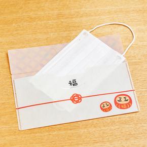 【ケース販売】【53円(税抜)×600入】福だるまマスクケース(マスク1枚付き)