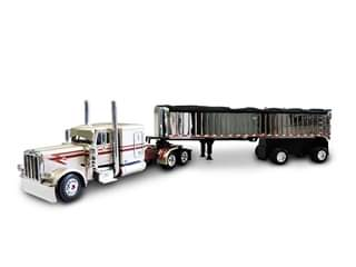 Peterbilt 389 with 63 Flattop Sleeper And Mac Frameless Spread-Axle Coal Dump Trailer